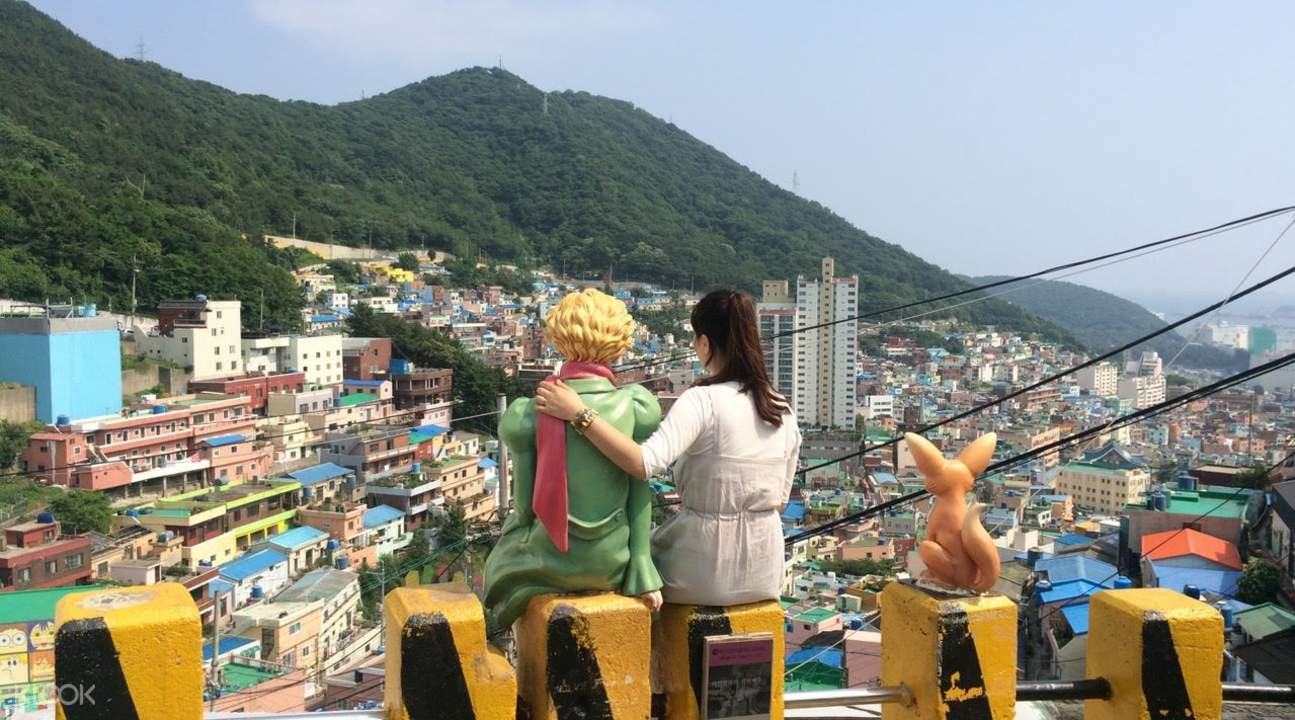 two women looking at houses in Gamcheon Culture Village